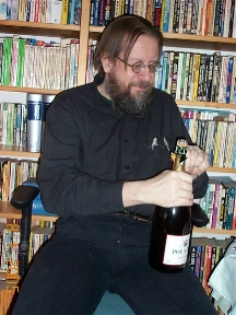 Juhani opening a bottle of wine