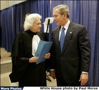 President George W. Bush and Supreme Court Justice Sandra Day O&#8217;Connor share a moment backstage March 3, 2005, prior to the swearing-in ceremonies for Michael Chertoff as secretary of Homeland Security. In response to the Justice&#8217;s resignation, President Bush called her one of the most admired women of her time and said he was proud to know her. File photo. White House photo by Paul Morse 