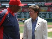 Washington Nationals manager and baseball hall-of-famer Frank Robinson chats with Allison Barber, deputy assistant secretary of defense, during ceremonies marking the Nationals' partnership with the Defense Department's
