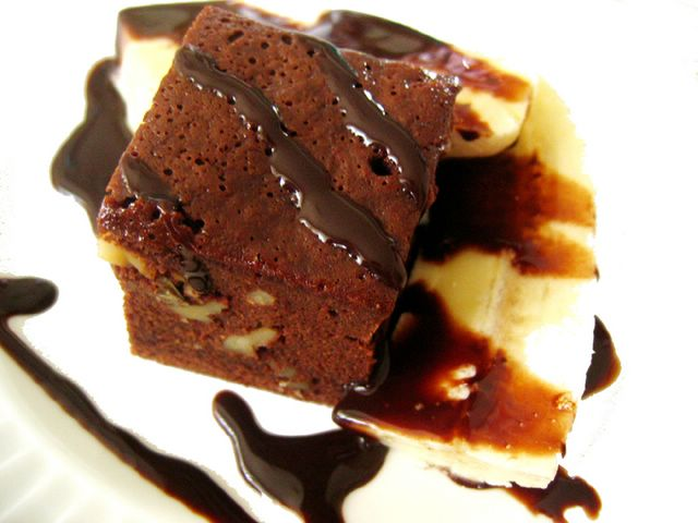 Divine Choc Brownie with banana and choc syrup