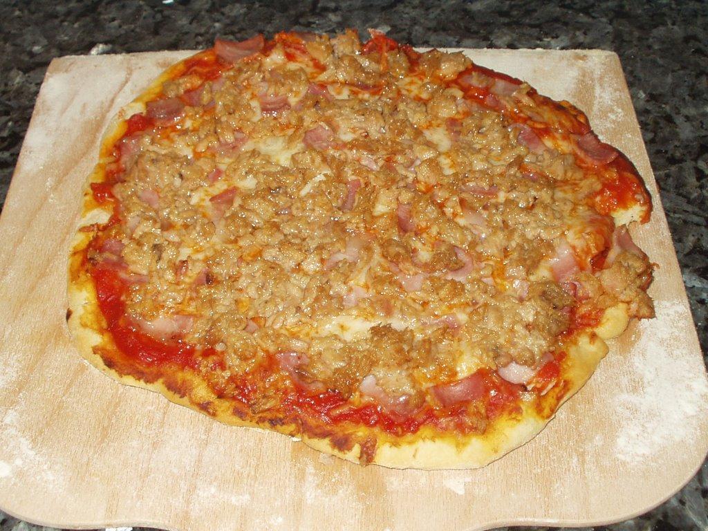 Cocina gumer pizza a la piedra for Pala horno pizza
