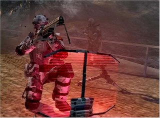 A support soldier is protected by a personal shield as a sentry gun and fellow soldier covers his left flank.