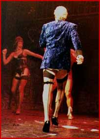 Nicholas Parsons played the narrator in Rocky Horror Picture Show. That is why he is wearing stockings. Possibly.