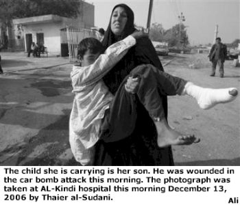 wounded child being carried by his mother