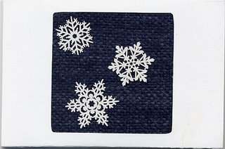 White card with handspun, handwoven navy blue inset & snowflake stickers.