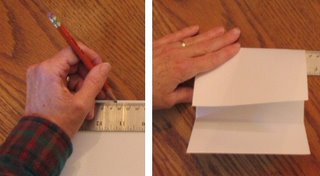 Marking the card to fold in thirds.