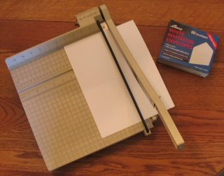 Cutting card stock so that the finished card will fit the envelope.