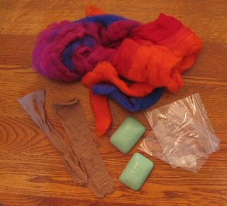 Supplies needed to make felted soaps.