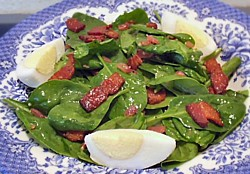 picture of spinach salad with hot bacon dressing and eggs