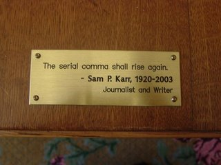 plaque on table in Multnomah County Central Library's Sterling Room for Writers that reads ''The serial comma shall raise again.'' Samuel P. Karr 1920-2003, journalist and writer
