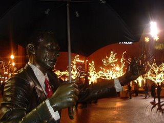Menorha seen over raised arm of Mr. Portland statue
