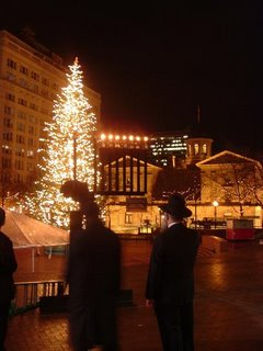 Menorha with Christmas Tree, Meier & Frank Department Store, and Pioneer Courthouse in background