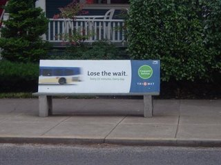 TriMet bus bench that reads ''Lose the Wait, Frequent Service, Every 15 Minutes Everyday, TriMet''