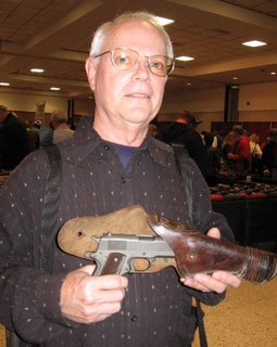 The original seller with the pistol. After purchasing it, I found him and asked him to pose with it.