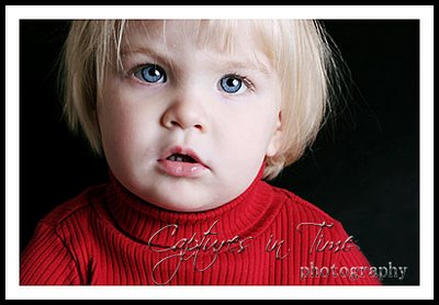 blonde girl in red sweater blue eyes