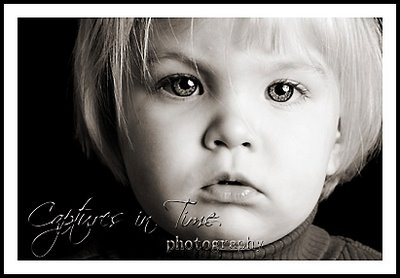 the camera loves her kansas city child photographer girl black and white with blonde hair