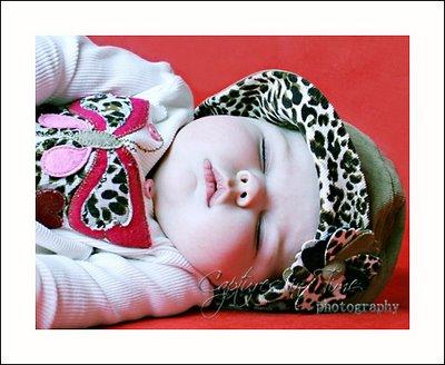 kansas city sister baby sleeping in leopard hat