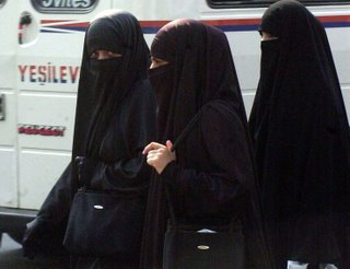 Picture: three Muslim women, veiled with the niqab