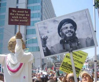 Picture: Demonstration with puppet of Gandhi alongside a photo of Nasrallah