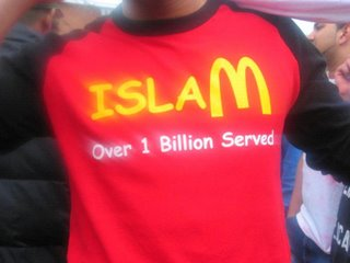 "Picture: Red T-shirt with yellow lettering, ""Islam - Over 1 Billion Served"", M as in the McDonald's logo"