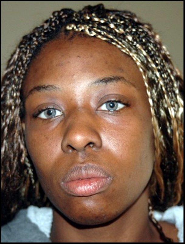Crystal Gail Mangum - police photo Mar. 16, 2006 - enlarged/enhanced