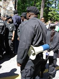 New Black Panther party sentry stands at attention for Chairman Shabazz