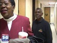 Travis Mangum follows Victoria Peterson at court hearing