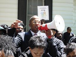 New Black Panther Party Chairman Malik Shabazz gesticulates menacingly