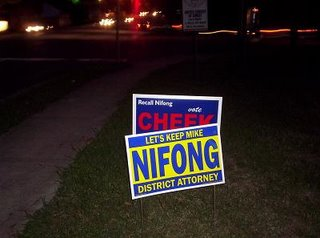 Nifong's campaign had put up one of their campaign signs directly in front of one of ours
