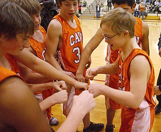 Cain Middle School teammates congratulated Mason Sevier after he hit his first basket in a game against Williams on Thursday. When word spread by e-mail that Mason was to play, hundreds came to the game to cheer him on.