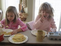 The girls have no problem throwing down pancakes