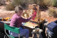 Bonnie Conrad painting at the Kayenta Art Festival