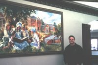 Roland Lee with library mural