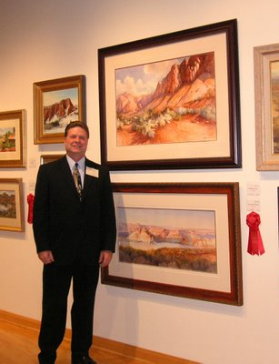 Roland Lee with award winnning painting at Sears Invitational Art Show