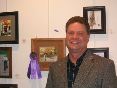 Roland Lee with Best of Show painting of fisherman at Virgin Valley Artists Lucky 13 International Small Works Competition