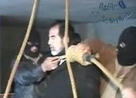 Video image released by Iraqi state television shows Saddam Hussein's guards wearing ski masks and placing a noose around the deposed leader's neck.
