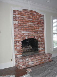 Faux paint red brick fireplace everything i create for Faux painting garage doors look like wood