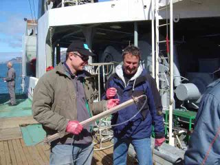 Andrew and Bill with water sample