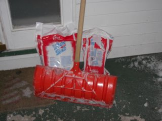 Picture of snow shovel, rock salt, and a house getting ready for a blizzard