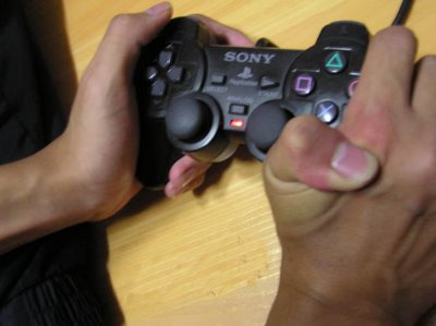 playstation 2 player bending finger backward