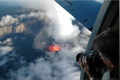 taking a photograph of volcano from above