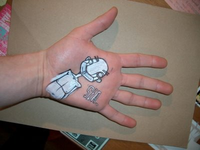 drawing on hand using ball pen