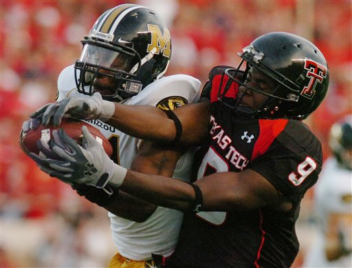 Missouri's William Moore steps in front of intended receiver Texas Tech's Robert Johnson for an interception returned for a touchdown, the second consecutive interception returned for a touchdown by Missouri, in the first half of a Big 12 Conference football game at Jones AT&T Stadium, Saturday, October 7, 2006, in Lubbock, Texas. (AP Photo/Joe Don Buckner)