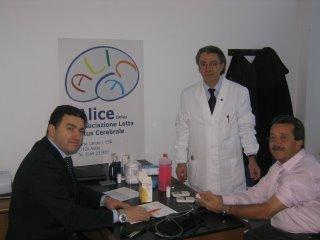 il dottor Marco Bacchieri Cortesi, il dottor Giuseppe D'Alessandro e il sindaco di Aosta Guido Grimod