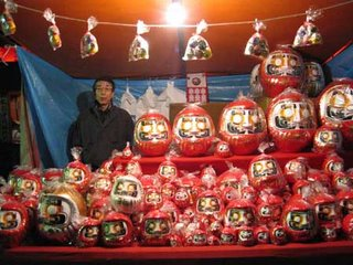 Daruma and maneki neko stall, Toyokawa Inari, Tokyo, at New Year.