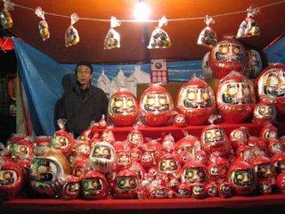 Daruma and maneki neko stall, Toyokawa Inari, Tokyo, at New Year.