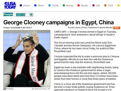 Screenshot of an article titled George Clooney campaigns in Egypt, China; accompanying photo shows Mr Clooney in a crown and a sash which says Sexiest Man Alive
