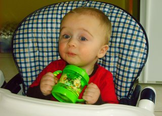 Max finally accepts his sippy cup.