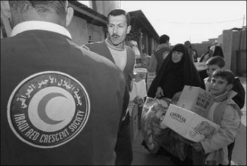 Red Crescent distributing food Iraq December 23 2006