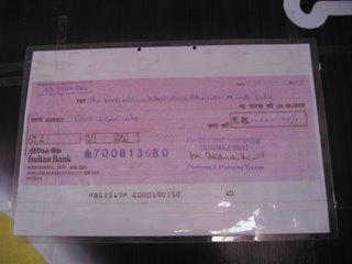 Cheque to Bapasi from Mu.Ka.